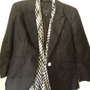Black linen jacket with white buttons